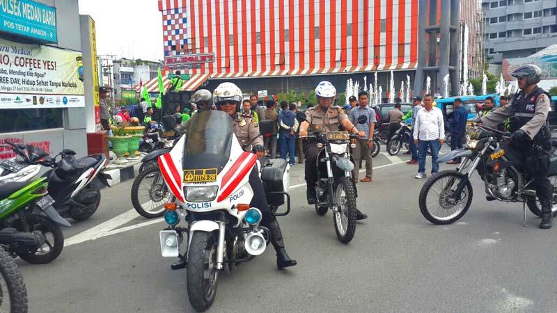 1 dari 1.841 Kapolresta Medan, Kombes Pol Mardiaz Kusin Dwihananto bersama Kasat Lantas, T Rizal Moelana saat memantau May Day. (tobasatu.com/ist)